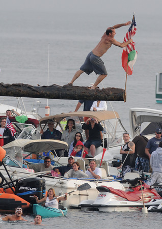 Gloucester: Joe Stelline takes down the flag in Saturdays Greasy Pole.Desi Smith Photo/Gloucester Daily Times. June 27,2009.