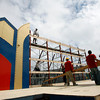 Gloucester: Bob Oliver, top, and Scott Clayton, bottom, wait for Mike Curcuru, Peter Clifford, Chris Doyle, and Giacomo Romeo to hoist a section of the altar for St. Peter's Fiesta, which begins next Wednesday. Photo by Kate Glass/Gloucester Daily Times Monday, June 15, 2009