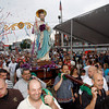 Gloucester: The statue of St. Peter is carried to the altar at St. Peter's Square during the official opening ceremony last night. Photo by Kate Glass/Gloucester Daily Times Friday, June 26, 2009