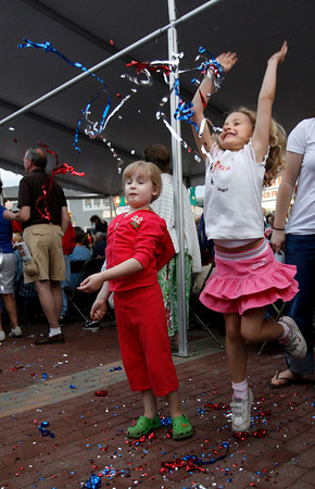 Gloucester: Julianna DaSilva, 5, left, and Jolie Frontiero, 6, play with fallen confetti at St. Peter's Square following the procession of St. Peter last night. Photo by Kate Glass/Gloucester Daily Times Friday, June 26, 2009