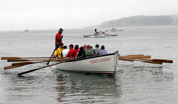 Gloucester: Jack Alexander (standing) and Paul Giacalone guided their team to an easy finish in the first heat of the men's seine boat races yesterday evening. Photo by Kate Glass/Gloucester Daily Times Wednesday, June 24, 2009