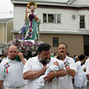 Gloucester: Dom Nicastro Sr. holds seven week old Benjamin Scola in front of Our Lady of Good Voyage church on Prospect Street during the Fiesta procession Sunday. Photo by Mary Muckenhoupt/Gloucester Daily Times