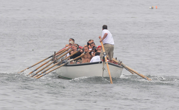 Gloucester: The crew Kaos races to the flag in the Senior Seine boat contest, in which they won saturday afternoon on Pavilon Beach.Desi Smith Photo/Gloucester Daily Times. June 27,2009.