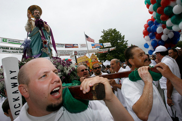 """Gloucester: Adam Orlando, left, chants """"Viva St. Pietro"""" as he carries the statue of St. Peter during the St. Peter's Fiesta Parade yesterday afternoon. Photo by Kate Glass/Gloucester Daily Times Sunday, June 28, 2009"""