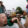 "Gloucester: Adam Orlando, left, chants ""Viva St. Pietro"" as he carries the statue of St. Peter during the St. Peter's Fiesta Parade yesterday afternoon. Photo by Kate Glass/Gloucester Daily Times Sunday, June 28, 2009"