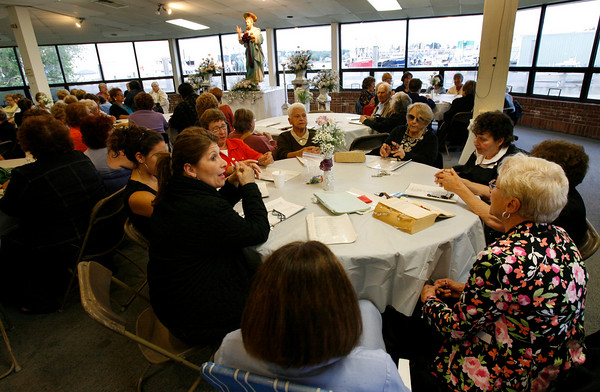 Gloucester: Over 100 people gathered for the first day of St. Peter's Novena, unofficially marking the beginning of Fiesta, at the old Doyon's building last night. Photo by Kate Glass/Gloucester Daily Times Monday, June 15, 2009