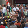 Gloucester: Stew McGillivray is toasted by former Sunday pole champ Sam Fronterio as he is carried up Pavilion Beach after grabbing the flag in the second round of the greasy pole contest Sunday afternoon. Desi Smith Photo/Gloucester Daily Times. June 28,2009