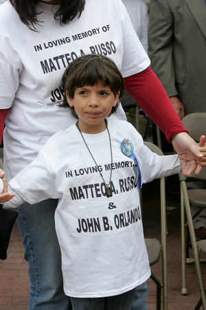 Gloucester: Alexia Carrancho, 7, standing with her mother Joanna, wears a t-shirt in memory of Matteo Russo and John Orlando during the Fiesta mass at St. Peter's Square Sunday. Alexia was Matteo's niece. Mary Muckenhoupt/Glouceter Daily Times