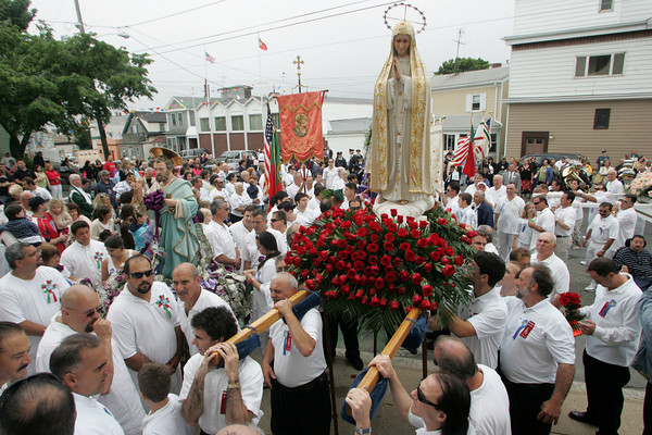 Gloucester: The statues of Our Lady of Fatima and St. Peter stop in front of Our Lady of Good Voyage church on Prospect Street during the Fiesta procession Sunday. Photo by Mary Muckenhoupt/Gloucester Daily Times