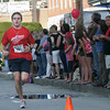 Gloucester: Gloucester Daily Times reporter Cameron Kittle runs in the Fiesta 5K Road Race on Thursday. Photo by Kate Glass/Gloucester Daily Times Thursday, June 25, 2009