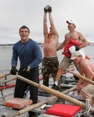 Gloucester: Joe Sanfillippo, Jim Tarantino, Tom Conrad and Tom Jarvis of Kaos celebrate their upset win over Seize the Moment in the senior seine boat race yesterday afternoon. Photo by Kate Glass/Gloucester Daily Times Sunday, June 28, 2009