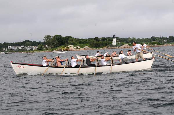 Gloucester:Seize the Moment Coxswain Joe Novello yells encouragement to his crew as they hold on to a small lead beating Kaos in the Senior Seine Boat Race,Sunday afternoon. Desi Smith Photo/Gloucester Daily Times. June 28,2009