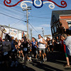 Gloucester: Fans line up along Commercial Street as runners start the Fiesta 5K Road Race yesterday evening. Photo by Kate Glass/Gloucester Daily Times Thursday, June 25, 2009
