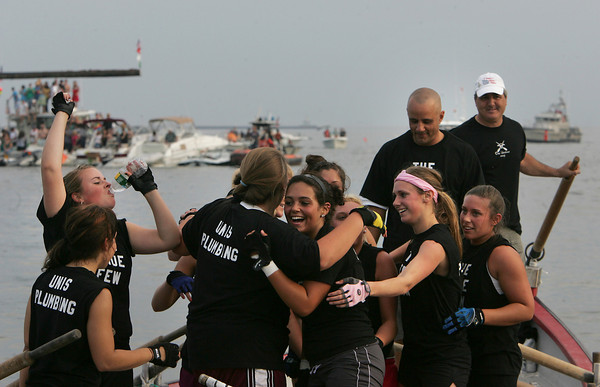 Gloucester: The True Few celebrates after winning the women's juniors seine boat race at Pavilion Beach Friday. Mary Muckenhoupt/Gloucester Daily Times