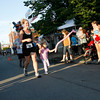 Gloucester: Blaize Davidson, 3, joined her mom, Kristen Davidson, for the finals stretch of the Fiesta 5K Road Race yesterday evening. Photo by Kate Glass/Gloucester Daily Times Thursday, June 25, 2009