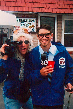 Gloucester: Sandy Palazzolo, left, and Vinny Parisi, right, dressed as a Channel 7 crew during Sunday's Greasy Pole last year. Photo by Kate Glass/Gloucester Daily Times