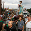 Gloucester: The statue of St. Peter is carried up Washington Street as the procession marches to St. Peter's Square during the official opening ceremony last night. Photo by Kate Glass/Gloucester Daily Times Friday, June 26, 2009