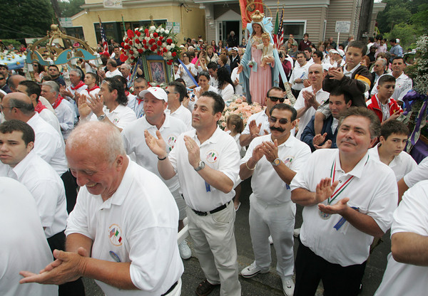 GLOUCESTER: People clap for Cardinal Sean O'Malley who spoke to the the crowd from the steps of the St. Ann Church during the procession for the Fiesta of St. Peter Sunday. Mary Muckenhoupt/Gloucester Daily Times