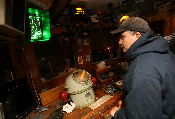 Gloucester: Joe Orlando guides the Padre Pio out of Gloucester Harbor at 3 am. Photo by Kate Glass/Gloucester Daily Times