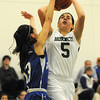 PAUL BILODEAU/Staff photo. Manchester-Essex's Sabrina Pallazola is denied the layup by Georgetown's Maya Spence during last night game in Manchester-by-the-Sea.