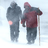 Desi Smith/Staff Photo.  Breanna and Jim Pappas of Essex make their way through the blinding blizzard near J.T Farnhams during Tuesday's blizzard. The couple wanted to go out for a walk.<br />  January 27,2015
