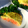 Heather Atwood/Special to the Times<br /> Roasted Salmon with Avocado Cream is served on a bed of collard greens chiffonade sautéed in sesame and grape seed oils and dusted with Gloucester's Atlantic Saltworks salt.