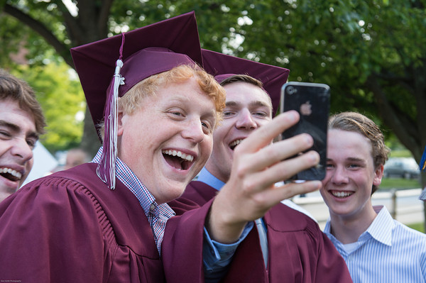 DESI SMITH/Staff photo.  Dan Gleesack (left) and Jake O'maley and others, share a Snap Chat Story and a good laugh,before heading inside for graduation, Friday night at Rockport High School.    June 6,2014