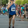 DESI SMITH/Staff photo.    Gloucester's Regina Loiacano heads to the finish in the Fiesta 5k placing first for the women, with a time of 18:00, Thursady night in St Peter's Square.<br />   June 26,2014