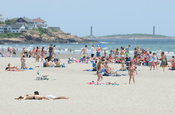 PAUL BILODEAU/Staff photo. Good Harbor beach was full of sunbathers  in Gloucester on a beautiful early Summer day on Tuesday.