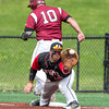DESI SMITH/Staff photo.    Gloucester's Jordan Pallazolla just beats the throw to first against North Andover in the D2 North Semifinals Friday afternoon at Frazer Field in Lynn.   June 6,2014