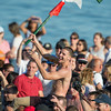 DESI SMITH/Staff photo.  Jack Russ is carried up the beach after taking down the flag, in Friday's Greasy Pole contest off Pavilion Beach.<br />   June 27,2014