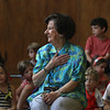 MIKE SPRINGER/Staff photo<br /> Connie Brown, 91, puts her hand over her heart while receiving thanks from teachers and students during an all-school assembly Wednesday at Manchester Memorial Elementary School in Manchester.  Brown is retiring after 14 years of service as a volunteer reading helper at the school.
