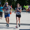 DESI SMITH/Staff photo.  Mark Potter of Manchester and his daughter Julia 15, are all smiles as they head to the the finish in the Father's Day 5k Road Race Sunday morning at Rockport Elementry School.       June 15, 2014