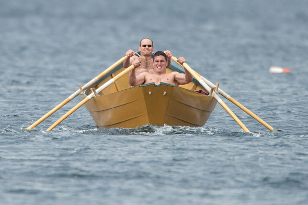 DESI SMITH/Staff photo.  Joe Cominelli (back) and Rob Morrissey push hard as they head out onto the course in the Seniors Heat 1 Dory Elimination Races at Niles Beach Saturday morning.   May 31,2014
