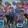 DESI SMITH/Staff photo.    Some young West Parish kids run in the Fiesta 5k Thursady night in St Peter's Square.<br />   June 26,2014