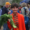 MIKE SPRINGER/Staff photo<br /> Robin Hubbard of Gloucester carries a handful of fresh herbs -- fennel, basil and cilantro -- that she bought Thursday on the opening day of the Cape Ann Farmers Market at Stage Fort Park in Gloucester.