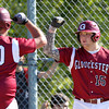Gloucester junior Bart Margiotta (15) greets senior Drew Shairs (20) after Shairs launched a deep home run to right to give the Fishermen a 1-0 lead in the 2nd inning of play at Nate Ross Field in Gloucester on Saturday afternoon. The top seeded Fishermen managed to stay alive in the D2 North Tournament with a 3-2 walk off win over ninth seeded Belmont in the bottom of the 7th inning as pinch hitter Tyler Favaloro singled home Lukas McRobb with the winning run. DAVID LE/Staff photo. 5/31/14
