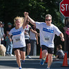 DESI SMITH/Staff photo.   Katherine Boucher and her Michael Boucher of Rockport, hold their hands up, as they head to the the finish in the Father's Day 5k Road Race Sunday morning at Rockport Elementry School.       June 15, 2014