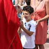 MARIA UMINSKI/GLOUCESTER DAILY TIMES Isaiah Francis 8 recieves his holy communion from Pastor James Achadinah during the Outdoor Mass for St. Peter's Fiesta on June 29, 2014.