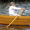 Jimmy Tarantino paddles hard at the start of the Mixed Doubles dory race on Saturday morning. DAVID LE/Staff photo. 6/21/14.