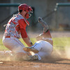 DESI SMITH/Staff photo.    Gloucester's Jordan Pallazola is thrown out at home plate against Masconomet, during the MIAA North Sectional Championship game held Saturday afternoon at LeLacheur Park in Lowell.    June 7,2014