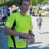 DESI SMITH/Staff photo.   Andrew Wagner of Cambridge,Mass, gets some water after placing first in the Father's Day 10k Road Race Sunday morning at Rockport Elementry School.<br /> Wagner's parent live in Rockport.       June 15, 2014