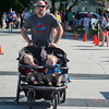 DESI SMITH/Staff photo.  Corey Chenette heads to the the finish in the Father's Day 5k Road Race pushing his twins Bradley and Camron Sunday morning at Rockport Elementry School.       June 15, 2014