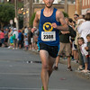 DESI SMITH/Staff photo.   Chris Grrange of Methuen,Mass heads to the finish in the Fiesta 5k placing first for the men, with a time of 16:25 Thursady night in St Peter's Square.<br />   June 26,2014