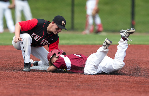 DESI SMITH/Staff photo.    Gloucester's Eric Chalmers dives into second and is safe, on a pass ball in the sixth inning against North Andover in the D2 North Semifinals Friday afternoon at Frazer Field in Lynn.   June 6,2014