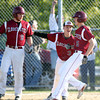Gloucester junior Lukas McRobb (5) is greeted at the plate by junior Devon Murray (3) and senior Peter Clark (9) after he scored the winning run in the bottom of the 7th inning at Nate Ross Field in Gloucester on Saturday afternoon. The top seeded Fishermen managed to stay alive in the D2 North Tournament with a 3-2 walk off win over ninth seeded Belmont in the bottom of the 7th inning as pinch hitter Tyler Favaloro singled home Lukas McRobb with the winning run. DAVID LE/Staff photo. 5/31/14