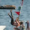 DESI SMITH/Staff photo.    Mark Allen grabs the flag at Sundays Greasy Pole Contest.<br />   June 28,2014