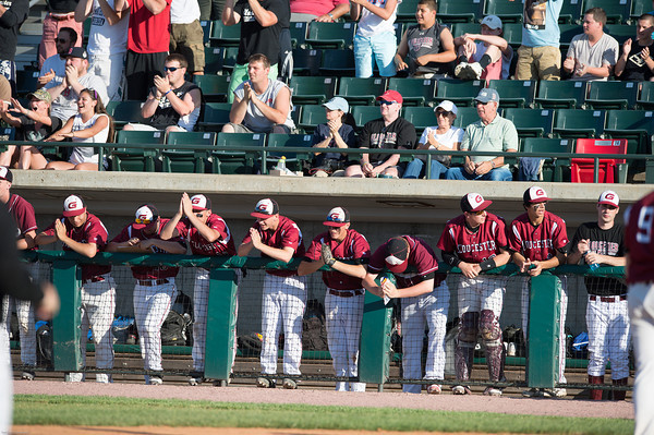 DESI SMITH/Staff photo.    Gloucester's players and fans cheer on their team as their start to ralley against Masconomet in the MIAA North Sectional Championship game against Masconomet held Saturday afternoon at LeLacheur Park in Lowell    June 7,2014