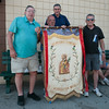 "DESI SMITH/Staff photo. Members of the St.Peter's Club, from left to right, Frank ""Munza"" Catania, Anthony Dias, Sam Novello and Jimmy Parisi, hold up the origanal bannner that hung in the first St.Peter's Club Saturday afternoon, outside the St.Peter's Club on Rogers St. <br /> June 28,2014"