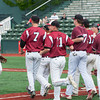 DESI SMITH/Staff photo.    Gloucester's pitcher Peter Clark (left) is rushed by his teammates after coming in to face the last batter in the seventh inning to recording the last out and save, against North Andover in the D2 North Semifinals Friday afternoon at Frazer Field in Lynn.   June 6,2014